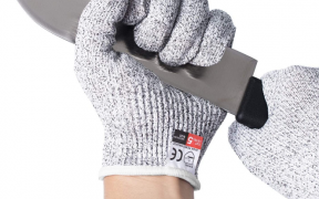 Hands with cut resistant gloves holding a knife