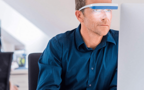 Man using light therapy glasses